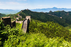 The Great Wall. It was in Jun 2013, the early summer of Beijing City. We climbed up the hills in the early morning and saw fog around the Great wall Stock Photo