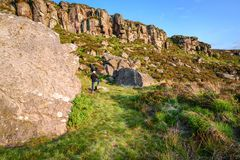 Great Wanney Crag and man to give perspective royalty free stock images