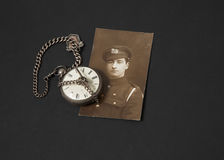 Great War Veteran and Watch. Photograph of a Great War veteran and antique pocket watch royalty free stock photo
