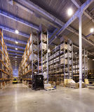 Great Warehouse. Big tall warehouse shelves and racks of commodity royalty free stock photography