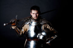Great warrior with sword and heavy armour Stock Images