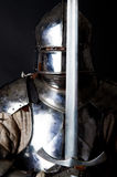 Great warrior with sword and heavy armour. Powerful heavy fighter with sword and helmet Stock Images