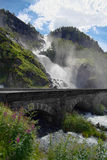 Great waterfall with a bridge royalty free stock photos