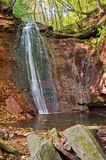 Great waterfall in the canyon in the woods. Cascade of waterfall Stock Photography
