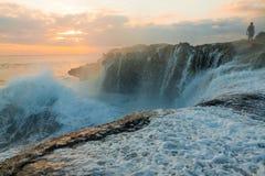 Great waves at Devil's Tear on Nusa Lembongan Sunset. Great waves at the Devil's Tear Sunset on Nusa Lembongan near Bali in Indonesia Royalty Free Stock Image