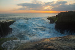 Great waves at Devil's Tear on Nusa Lembongan Sunset. Great waves at the Devil's Tear Sunset on Nusa Lembongan near Bali in Indonesia Stock Photography