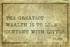 Great wealth Plato. The greatest wealth is to live content - ancient Greek philosopher Plato quote printed on grunge vintage cardboard Royalty Free Stock Photos