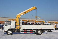 Great white auto truck crane standing on construction site in winter - Russia, Crimea -January, 21, 2016 Stock Image