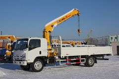 Great white auto truck crane standing on construction site in winter - Russia, Crimea -January, 21, 2016 Royalty Free Stock Images