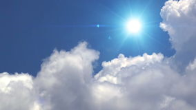 Great white clouds with sun over the clean deep blue sky. stock footage