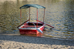 Great White Egret and small boat at Huacachina Oasis - Ica, Peru Royalty Free Stock Images