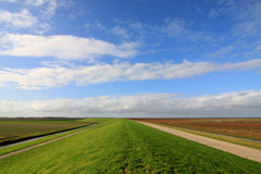 The great wide open. Green dike in wide open landscape Stock Images