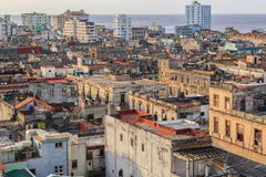 Great  wide open view of old antique Cuban authentic Havana city against ocean and sky background at sunset time Royalty Free Stock Photos