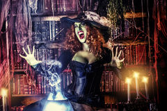 Great witch. Fairy wicked witch in the wizarding lair. Magic. Halloween Stock Photo
