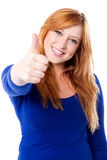 Great work guys, keep it up!. Young smiling girl showing thumbs up stock photos