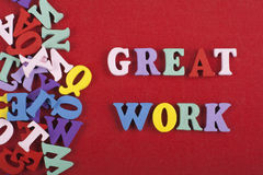 GREAT WORK word on red background composed from colorful abc alphabet block wooden letters, copy space for ad text Royalty Free Stock Photos