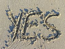 Great written YES engraved on the sand of the Sea Beach Stock Photography