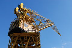 Great yellow harbor container crane. Under the blue sky Stock Image