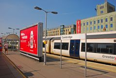 A Greater Anglia train stopping at Cambridge station waiting for passengers Royalty Free Stock Image