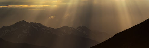 Greater Caucasus Mountain Range in beams of evening sun. Stock Images