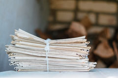Greater pack of newspapers on a table with a rope Royalty Free Stock Images