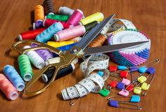 Greater sewing scissors, color a thread, a measuring tape and pi Royalty Free Stock Photos