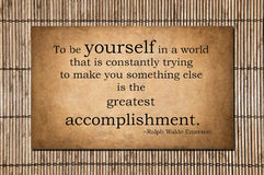The greatest accomplishment - Emerson quote. To be yourself in a world that is constantly trying to make you something else is the greatest accomplishment. Ralph Stock Photo
