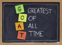 Greatest of all time - GOAT acronym. GOAT acronym (greatest of all time ) - sticky notes and white chalk handwriting on blackboard stock images