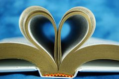 Bible pages curled as a heart