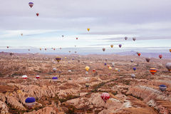 The greatest tourist attraction of Cappadocia, the flight with the hot air balloons over the valley in Goreme Stock Photos