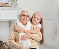 Greatgranddaughter and greatgrandmother Royalty Free Stock Image