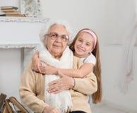 Greatgranddaughter and greatgrandmother Royalty Free Stock Image