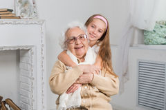 Greatgranddaughter and greatgrandmother Royalty Free Stock Photography