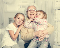 Greatgrandmother with two greatgranddaughters Stock Photography