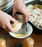 Greating cheese on grater Stock Image