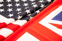 The greatness of America and Britain. Two state flag folded in h Royalty Free Stock Photos