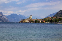 The greatness of the mountains. The greatness of the Alps and the city of Malcesine, Italy Royalty Free Stock Image