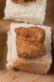 Greaves na plasterek grzanki chlebie Fotografia Stock
