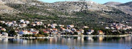 Grebaštica, Croatia, panorama. Grebaštica, near Šibenik, Croatia, panoramic view of coast and houses reflecting in sea Stock Photos