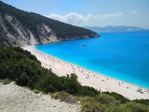 White blue and green beach stock photo