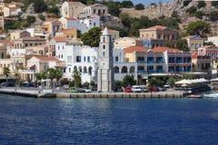 Grecia, la isla de Symi Puerto y Clocktower foto de archivo