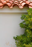 Grecia Pared con el olivo y las tejas Fotografía de archivo