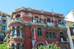 Grecja, fasady, jaskrawi soczyści kolory czerwień dziejowa obrazy royalty free