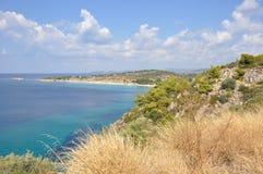 Grecs, côte, vagues en mer image libre de droits