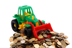 Gree bulldozer raked pile of coins Royalty Free Stock Photo