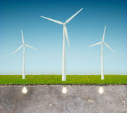Gree energy concept with windmill. Blue sky and light bulbs Stock Photography