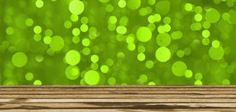 Gree light  bokeh background or texture and wooden table Stock Images