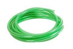 Gree plastic hose. Isolated on white background Stock Photography
