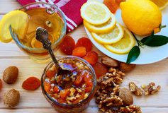 Gree tea with lemons and honey mix with apricots and nuts stock photos