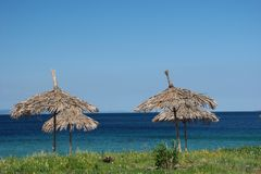 Greece. Sea with blue sky and sunshade, horizontally framed shot stock photos